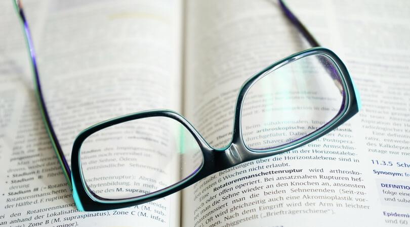 Eyeglasses sitting on an open book