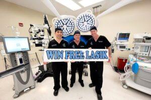 Eye doctors holding win free lasik sign