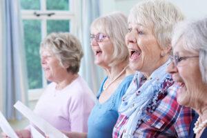 group of four women singing